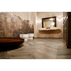 This unusual Fumed and Limed Chevron flooring is from Italian manufacturer Listone Giordano. Each plank has been fumed leading to a large variation in col Tiles Uk, Chevron Floor, Floor Patterns, Carpet Tiles, Floor Design, Siena, Architecture, Corner Bathtub, Plank