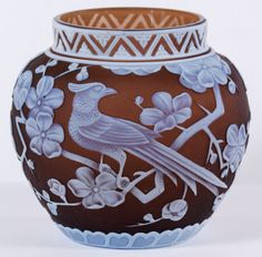 Lot 413: Thomas Webb & Sons Cameo Glass Shoulder Vase in Raisin; Having a pheasant in a dogwood tree motif on raisin color with an intricately decorated Aztec rim; provenance: Maude B. Feld