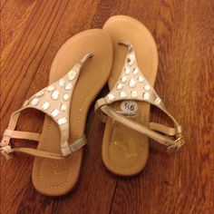 Size 9.5 sandals. Never worn, just wore inside house to try them out and didn't like them: no scratches, rips', or tears'. Shoes Sandals