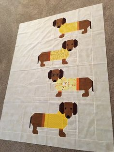 "My "" DOGS IN SWEATERS "" quilt is all sewn together...       I am very happy how it came out with the Batik fabric background      My favo..."