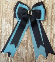 These hair bows are perfect for your leadliner or short stirrup rider. This is a three layer hair bow set with a metal rhinestone square center for that subtle touch of bling every girl loves. It can also be finished with a standard wrapped ribbon center. This set measures 8 inches from top to bottom 6 inch tails. All ends have been heat sealed to prevent fraying.    I have hundreds of rolls of ribbon on hand so I can quickly make a custom bow set with your favorite colors. Most of our bows…
