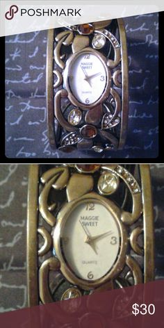 Maggie Sweet Cuff Watch Unique and gorgeous cuff watch. You will truly love this piece. It unhinges on back to get wrist in and out. Stunning arm jewelry for a lucky lady. Floral, amber, gold tone and accent diamonds all around cuff. Must have! Still has protective cover over clock. Pull off when you purchase, if you wish?? I do apologize but the battery is not included. maggie sweet Jewelry Bracelets