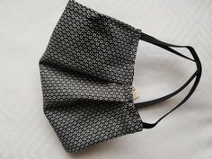 Black square pattern mask lovingly handmade by me in my smoke free and pet free home in Switzerland. 100% Premium Cotton Face Mask with Nose binding and a air filter pocket. Washable Reusable Everyday Protective Face Masks. All of our masks are lined with 100% premium cotton. The outer layer is