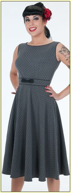 This classic 50's style dress will flatter any shape. This gray dress has small black flocked polka dots and features a boat neck neckline, fitted bodice accentuated with black bow, swing skirt and back zip! Adorable!