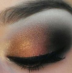 Gold, copper, bronze, and black eye makeup