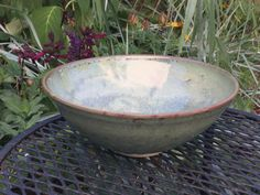 Wheel-thrown bowl with celadon green color by SpinningSongPottery
