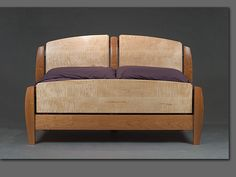 Curly maple and cherry. http://www.solomonrossfurniture.com/other/oth_images/buchi_bed.jpg