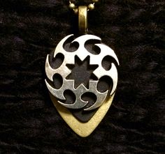 Metallic Saw Pendent with choice of Chain Length $28