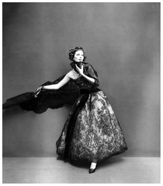 Suzy Parker in Dior's sumptious evening gown of black Chantilly lace over pale chiffon with black velvet streamers and lace scarf, photo by Avedon, Paris studio, August 1956