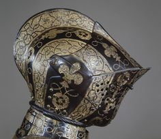 Very beautifully worked helmet, intricate detailing and forms.