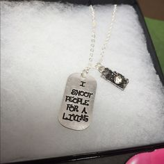 Dog Tag Necklace I shoot people for a living  Dog Tag Necklace perfect for your favorite photographer! I SHOOT people for a living  silver color dog tag includes clear crystal bling camera charm  Photographer Dog Tag  Jewelry Necklaces