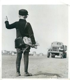 1942- Icelandic newsboy takes advantage of a new order issued by the U.S. military authorities that all hitch hikers are to be given a lift. The photograph was taken July 31.
