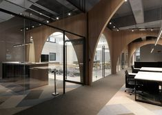 """Arched wooden partitions are used to separate the workspaces from an indoor """"courtyard"""" inside fashion brand H&M's logistics office in Taiwan"""
