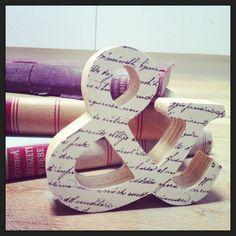 Símbolo & de madera