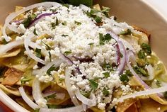 Green Chilaquiles in Roasted Tomatillo Sauce by Patti's Mexican Table Pati's Mexican Table is a site for Pati Jinich to share stories, tips and recipes for cooking mexican food. Pati Jinich is a cookbook author, chef of the. Vegetarian Mexican, Mexican Cooking, Mexican Food Recipes, Asian Cooking, Yummy Recipes, Vegetarian Recipes, Yummy Food, Tomatillo Sauce, Roasted Tomatillo
