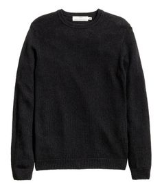Dark blue. Knit sweater in a wool blend with ribbing at neckline, cuffs, and hem.