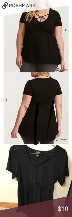 Strappy Babydoll Top Cinched babydoll top with the cute strappy criss-cross detail. Slightly longer in the back, so it looks really cute with leggings! torrid Tops Tunics