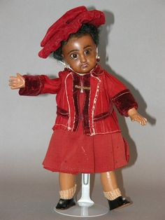 Jumeau antique black doll in red. Antique