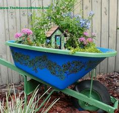 Make your backyard even more magical by using a wheelbarrow as a platform for a fairy garden. Get the tutorial: http://cntry.lv/6188BQUIC