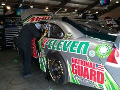 Interior mechanic Adam Jordan works on the No. 88 Chevrolet at Auto Club Speedway on March 23.