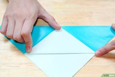 How to Make an Origami Sailboat. Interested in adding a sailboat decoration to your desk, or perhaps creating a gift tag? This article sets out how to make an origami sailboat which you can use in many different ways. Origami Sailboat, Used Sailboats, Sailboat Decor, Buy A Boat, Origami Art, How To Better Yourself, Plastic Cutting Board, Gift Tags, Things To Come