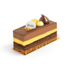"""HEROIC."" Entremet consisting of bold dark chocolate, caramel, hazelnut, mango and passion fruit. A harmony of sweetness, acidity and bitterness."