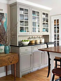 LOVE this built-in. Perfect and gorgeous kitchen storage. I want this in my dining room.