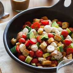 Our Simple Panzanella Salad has cherry tomatoes, cucumbers, mozzarella balls, and toasted bread chunks tossed in a balsamic vinaigrette.