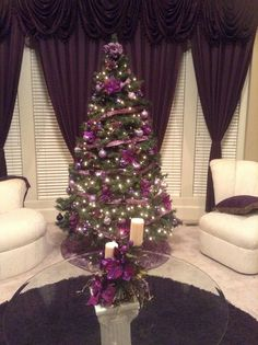 Purple Christmas tree and purple drapes and cushions. Purple Christmas Tree Decorations, Christmas Tree Design, Noel Christmas, Christmas Colors, Xmas Tree, Christmas Photos, White Christmas, Holiday Decor, Gold Decorations