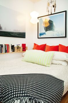 A mess of throw pillows, great art, and a shelf full of books — what more could you ask for? #refinery29 http://www.refinery29.com/pinterest-worthy-bedrooms#slide-30