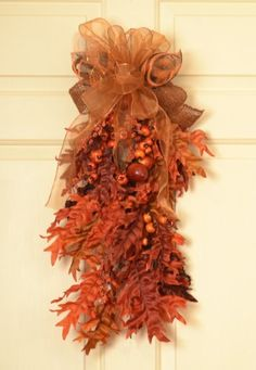 "The Autumn colors in this Fall door Swag will bring life to your front door. It's created with layers of silk oak leaves in fall colors which will retain their natural splendor. Branches, acorns and pine cones and a large jute bow adds the finishing touch. Fall Door Swag measures 30"" long At Floral Home Decor, we can create any type of silk wreath, door basket, swag or floral design you need in colors to coordinate with your home. Christmas Tree Bows, Xmas Ornaments, Xmas Tree, Door Swag, Fall Door, Oak Leaves, Fall Projects, Xmas Decorations, Pine Cones"