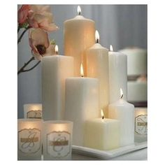 put varying-height pillar candles in cylinder vases for centerpieces.