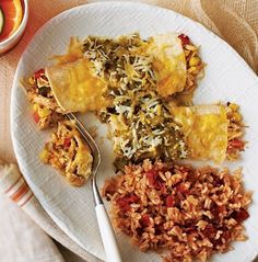 With spicy green salsa and classic red rice, this dish celebrates the colors of the Mexican flag. Enchiladas bake while stacked over the simmering rice, filling your house with the aroma of your favorite cantina.