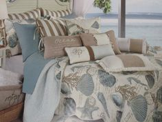 blue and white shell bedding set on the bed complete with mocha pillows. Pleasing Idea Of Beach Theme Bedding Make You Being Cozy Beach Theme Bedding, Coastal Bedding, Coastal Bedrooms, Coastal Living Rooms, Luxury Bedding, Tropical Bedding, Beach Bedding Sets, Tropical Quilts, Nautical Bedding