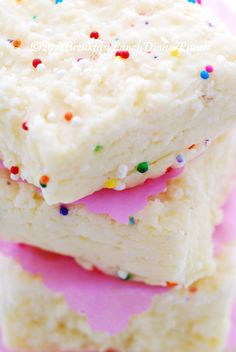 """Barfi   Makes 30    Ingredients    4 cups full cream milk powder   1 cup double cream  1 1/2 cups granulated sugar   3/4 cup water  1 tsp rose water  2 pieces fresh ginger (each about 1/2"""" x 1/2"""")  1/4 tsp ground cardamom   coloured sprinkles  butter for greasing dish."""