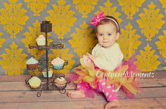 Baby girl photo prop cupcake fake cupcake photography prop shoot ,first birthday party centerpieces decoration pink icing. $13.99, via Etsy.