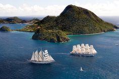 Star Clippers' Royal Clipper ship sailing along Iles des Saintes in the Caribbean.