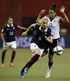 France's midfielder Amandine Henry (C) vies with Germany's forward Celia Sasic during the quarter-final football match between Germany and France in the 2015 FIFA Women's World Cup at the Olympic Stadium in Montreal, Quebec on June 26, 2015.