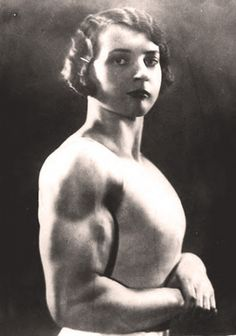 "Strong woman and acobat Louise Leers (aka Luise Krökel), 1930s.   Some of the images of the badass strong women in this post date all the way back to the very early 1900s however the female ""strong woman"" was an attraction as long ago as the early 1700s where women such a the ""Female Italian Samson"" and the ""Little Woman from Geneva"" would perform impressive feats of strength such as bearing massive amounts of weight on their backs or effortlessly hoisting several men in their arms.   …"