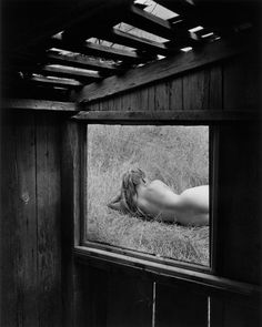 Wynn Bullock (American, 1902–1975), Barbara through Window, 1956.