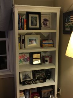 Simple Target bookshelves made over using chalk paint and peel and stick wallpaper