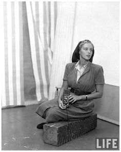 LIFE photographer Nina Leen posing with Rolleiflex camera1949