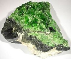 green diopside Diopside is a pyroxene mineral with a chemical composition of MgCaSi2O6. It occurs in igneous and metamorphic rocks at many locations around the world.  Gem-quality crystals of diopside are faceted into attractive gemstones that are occasionally seen in commercial jewelry. Granular diopside can be easily cut and polished. When it has an attractive color, it is sometimes used as an ornamental stone.  Perhaps the most important use of diopside is its value as an indicator…