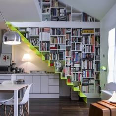 Not the colour of the stairs but the bookshelf wall idea! Salon - Marie Claire Maison