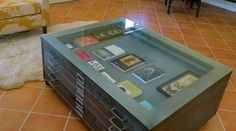 Custom Industrial Flat File Cabinet coffee table. Glass top, Brushed metal, satin finish.