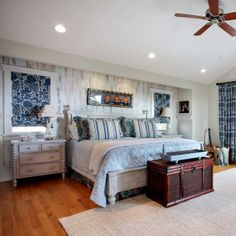 modern bedroom decorating with beautiful bedding fabrics and blue curtains