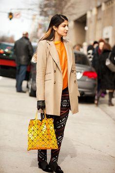 printed pants and yellow bag
