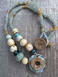 Blue and Golden Ceramic Urchin Pendant with Ceramic and Glass Beads on Linen Thread  $50