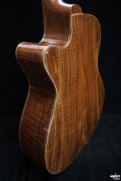 Waghorn Hydra acoustic guitar in Claro Walnut with Koa binding.
