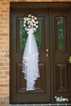 Flowers on the front door for the wedding day